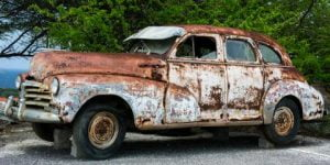 Old broken vintage car that has began to rust