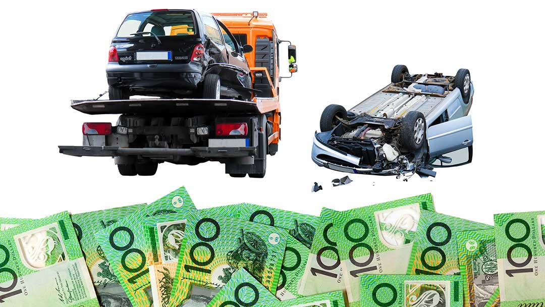 Australian money bills in 100s and broken cars towed by a towing truck
