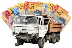 Australian money bills and a truck with a wrecked front