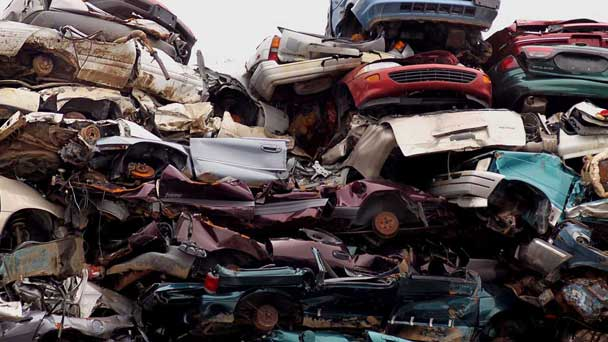 Different Junk Cars On A Scrapyard