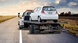 Car being towed away by car removal company.