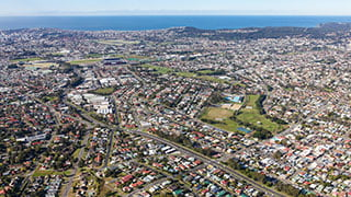 View from the air looking over Newcastle area including properties and coast.