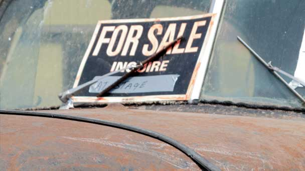An Old Car Displayed For Sale